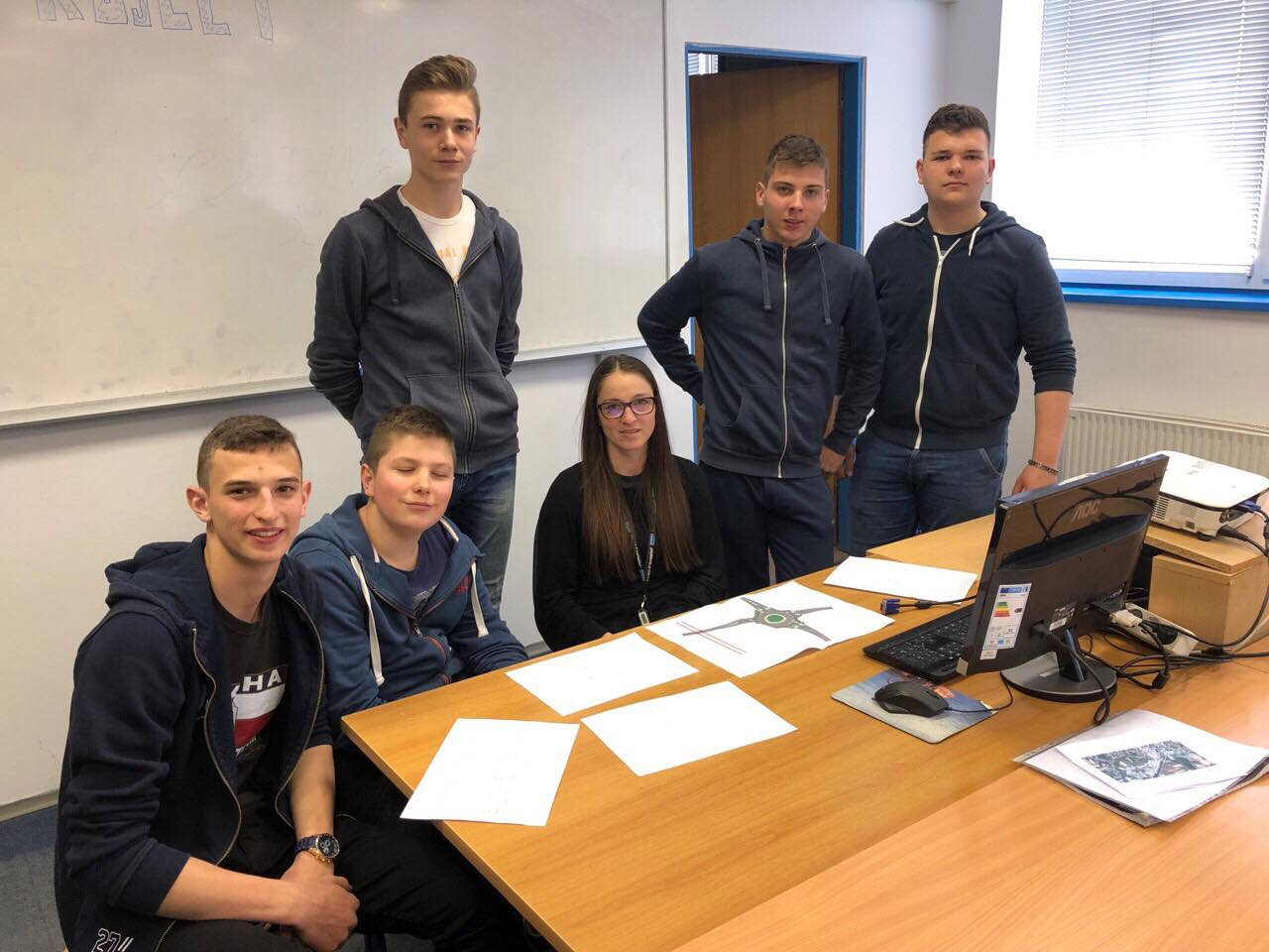 Teacher Maja Gregar with her team of students who worked on this project