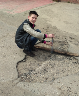 At measuring the potholes